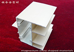 Magnesium alloy shaped materials